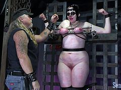 Rose is bound up in the dungeon, being tended to by the incomparable Master James. She is bound and sightless, courtesy of the goggles she's wearing. Her breasts are squished to the point they turn red, graduating to purple. The vibrator between her legs adds some ooh to the ouch.