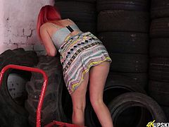 Yummy plump pussy of slutty red head from the tyre store