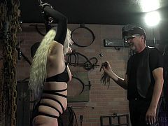 Pain turns her on so much that she has come to the dungeon to be tied up and whipped by the master. She is gagged and treated like a sex slave, but she really likes it and that turns her on so much that she cums.