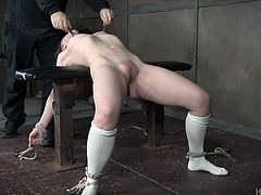 Tied up red haired harlot Kel Bowie gets her muff punished