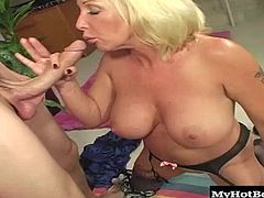 When his buddy stops by to get his address and thats when his huge boobed blonde MILF seduces him by giving him an upskirt of her meaty stocking clad legs, along with letting him see her cleavage. Soon, she gives him a blowjob, rides on his pole and gets a facial and pearl necklace cumshot.
