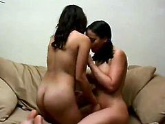 Two dark-haired girls are having some good time together. They kiss and stroke each other's natural tits and shaved pussies and seem to enjoy themselves.