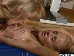 Apartment has a gym that they frequent to keep their bodies in shape. One day while doing some floor exercises, the blonde with the small tits gets arouse watching the big boobs on her girlfriend bouncing so she grabs one and begins sucking on her nipples before performing cunnilingus.