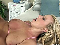 Sexy milf Carolyn Reese playing with her boobs and wet pussy.