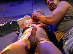 He knows the best way to control his gay slave and inflict the right amount of pain and pleasure. The slave is bound tightly in rope and his hard cock gets jerked and squeezed. The masters lick his feet and make him cum.