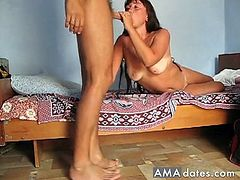 An amateur brunette kinky milf slut sucks the big cock of her lover on bed and then she gets her pussy fucked hard.