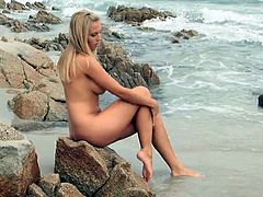 Amazing blonde beauty naked on the beach