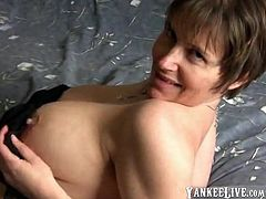 A matured slut with a nice blonde short hair, lying on the bed while rubbing her nipples and finger her nasty huge cunt.