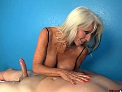 Mature massage therapist loves getting tips. She's always ready to urge clients to request something extra