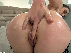 Oiled slut Tiffany Doll gets bent over and fucked in the ass