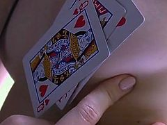 Playing cards cover her tits and cunt in a sensual tease