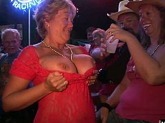 They pull off their shirts to let you have a look at heir large natural boobs. Next, a couple MILFs will flash their hooters at you, along with one blonde who gives you a close up of her perky knockers and big, suckable nipples plus, one older BBW lady will pull off her bra and show off her floppy tits.