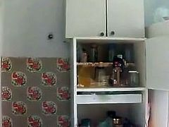 Russian girl masturbates, squirts and pees in the kitchen