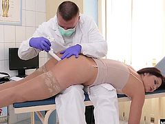 After a brief exam, the doctor figured out that what she really needed was to cum. So he puts on some purple exam gloves and he focuses on playing her her ass and pussy while stimulating her clit so that she would explode with pleasure.