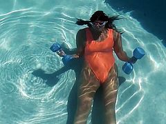Sexy one piece swimsuit on a girl working out underwater