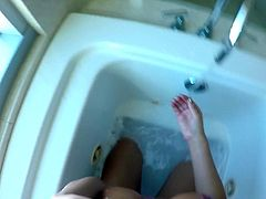 Wench August Ames takes a bath before a steamy POV sex