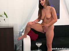 Czech pee fetish chick Nicolette Noir masturbates her wet and delicious pussy