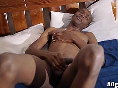 Black African twink James wakes from a slumber with the urge to jerk off. Already naked under a sheet, he grabs his big uncut cock and starts working up a boner. Once hard, the skinny and smooth young man begins stroking with determination. We enjoy a good look at his body, when James gets up on his knees to beat off and then he kicks back and heads for climax. By the time this ebony beauty reaches his goal, theres a splattering of warm cum on his tummy.