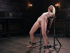 Some women need to be gagged when they're being toyed with, and Chloe is definitely one of them. She gets loud when stimulated and even louder when she's cumming, so she gets a ball gag before getting started. Her executor uses a vibrator on her, then changes her position for some spanking as well.