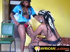 Busty ebony lesbians are having fun together with one of them wearing the police uniform and she is the designated punisher