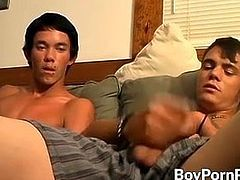 Two skater dudes are stroking their uncut dicks together