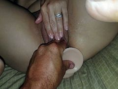 Fisting my wifes pussy with a didlo in her ass