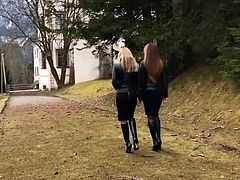 Two lady's in tight skirts and boots