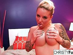 Curvy tattooed starlet Christy uses a toy on her tight pussy