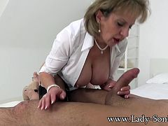 Mature married Lady Sonia is the queen of happy endings. She takes this ever willing lad onto her massage table, jerks him off and sucks his cock while her husband films her.