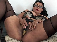 Danica Collins plays with a big rubber cock