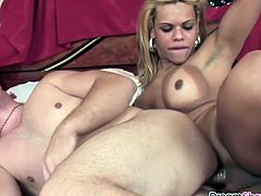 Horny and hot blonde shemale Erika Backster with amazing big boobs and round latin ass gets her mouth filled up with dick before getting fucked.