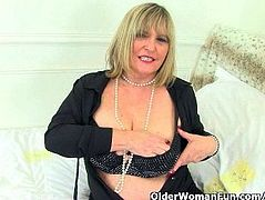 British granny Alisha Rydes loves wearing stockings when she masturbates