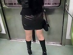Wife walking in black leather mini skirt & boots