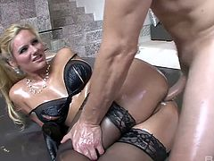 Blond hooker Phoenix Marie gets her anus oiled up and rammed