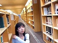 student flashes in library