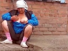 Russian granny shows her tits off