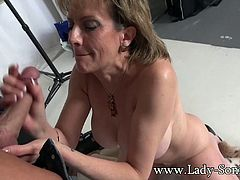 Lady Sonia finds herself in a photographers studio and within seconds shes butt naked on her knees sucking his ever-inviting hard cock! This mature MILF loves having her mouth fucked!