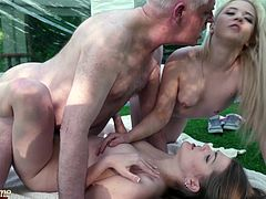 Old guy wants to help young russian girls to take down their tent, but the sluts have a better plan: they want to share him and his cum.