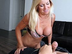 Milf walks into her room in her bikini and finds her boyfriend jerking his cock to pornography on his phone. This turns on mature lady and she starts licking his cock big time till he finally releases his load in her mouth.