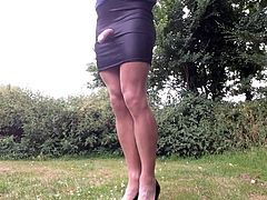 Special black mini skirt outdoors .