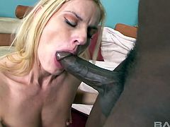 Sexy blonde Darryl Hanah knows what a black guy wants from her