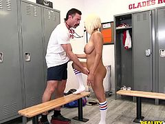 Yello is in the men's locker room, naked save for socks, masturbating on one of the benches. The coach catches her, giving her grief about being in there. She silences his objections by sucking his cock, which works with pretty much any guy.