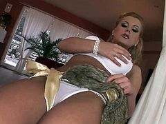 Dorothy Black is a classy lady with a great sense of style and finesse. In this great scene she poses at home while wearing a sexy white bra and panties, high heels and a fur shawl. You'll love her gorgeous blonde hair and sexy attitude!