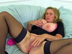 This mature lady really loves to show off her amazing boobs. The sexy mature woman spreads her legs wide and shows off her old pussy. Watch her rub her sensitive nipples with her panties and make herself cum very hard.