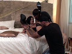Slender brunette Lulu Martinez plays with two cocks at the same time