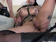 Two sex-hungry hookers in sexy outfits enjoy toying each others slits