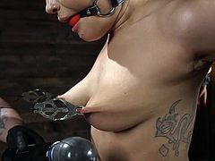 This severe guy knows his work and this is the only reason why this hot milf with clamped nipples and stretched pussy lips is moaning from pleasure... Join us and enjoy hot helpless women versus hard metal bondage.