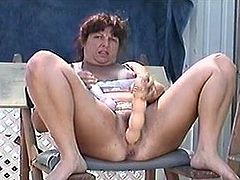 Mature housewife plays with big toy