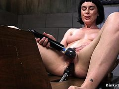 Wet brunette pounds cunt with machine
