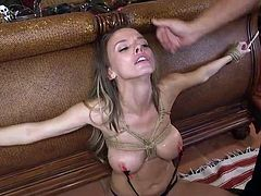 He uses nipple clamps on her big tits, to make her cry from pain. Then rope bondage comes into play, before he pulls his erect dick out of his pants and puts it in her mouth. Join our crazy BDSM fantasies!